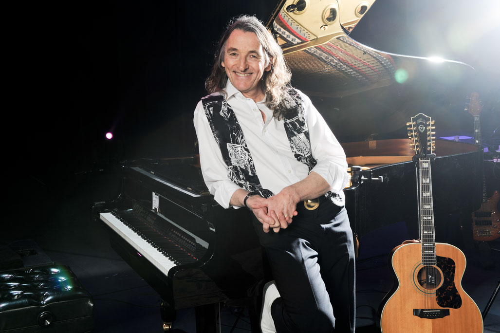roger hodgson leaning on piano